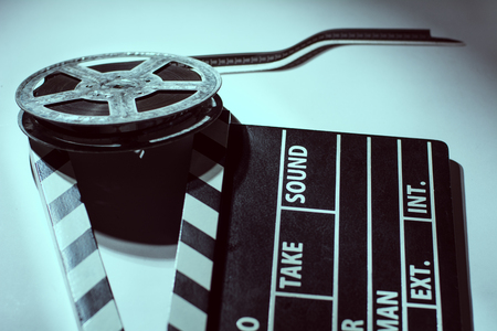 clap: Old rusty roll of film and cinema clap. Toned image