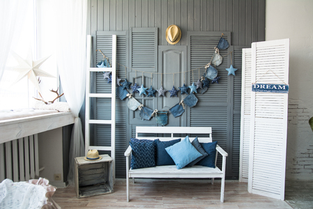 decorate: Interior wall with bench and decorations of jeans. Designed in the style of jeans Stock Photo