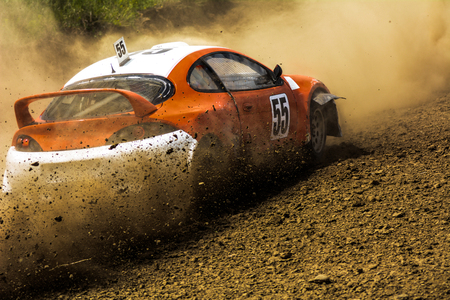 Cars on the autocross. Racing in the open air with dust. Stock Photo
