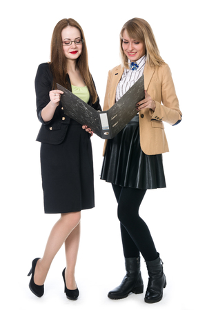 Two young business women in full growth isolated on white background