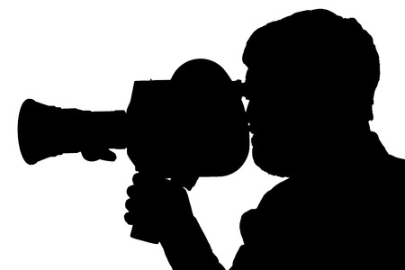 Silhouette of a bearded man in the side of the camcorder. cinema operator, documentary TV