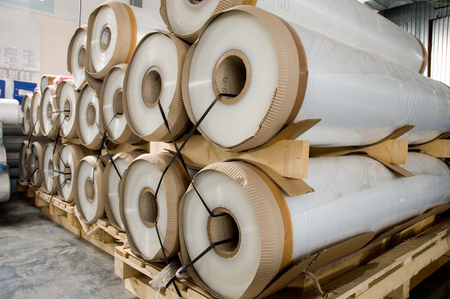 polyethylene film: Large rolls of transparent polyethylene lie on a pallet. Packing film in a dry warehouse