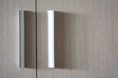 Background wooden texture door with plastic metallic handles. Imagens - 97207581