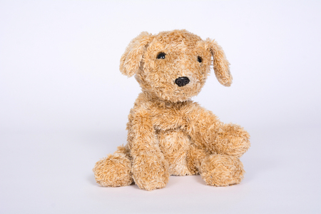 Soft toy dog on a light background. Banque d'images - 118652807
