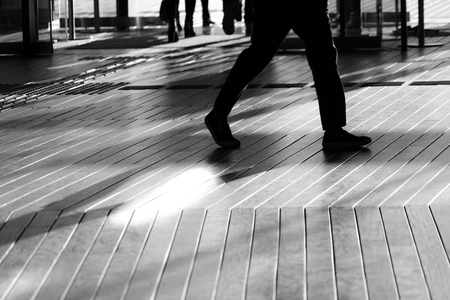 Shadow of people that walk the wood deck Stock Photo