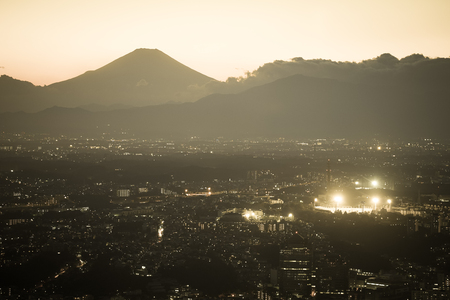 Fuji of the silhouette and the Yokohama skyline