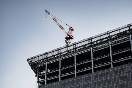 Bill and large cranes in construction