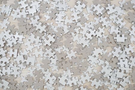 White jigsaw puzzle that has been placed on a desk