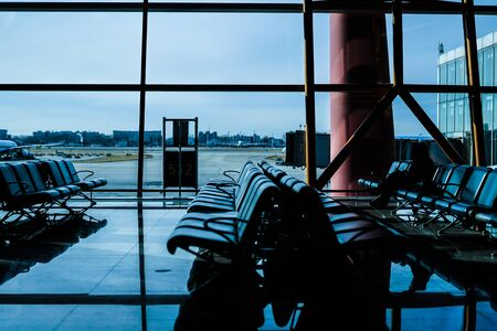 Waiting room and the silhouette of the Beijing International Airport