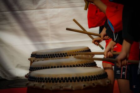 Images of children that hit the taiko