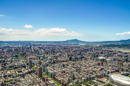 Taipei cityscape and blue sky visible from Taipei 101