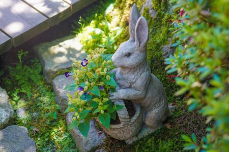 Rabbit of the statue and the fresh green