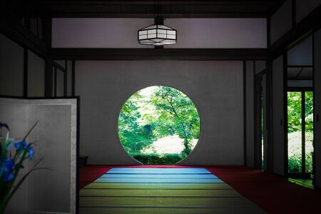 Round window and the fresh green of Meigetsuin