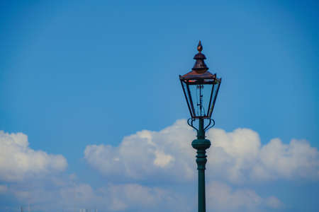 Streetlights and early summer of blue sky
