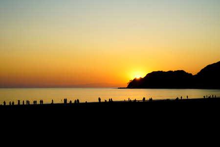 Dusk and the people of the silhouette of Kamakura coast Фото со стока