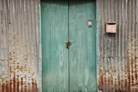 The Zinc Wall with Blue Door 写真素材 - 110563129