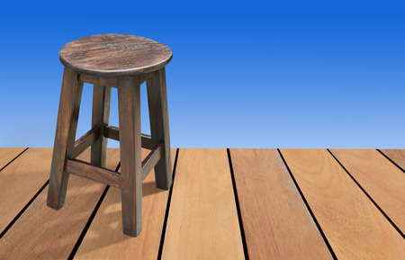 Wooden chair on a wooden background color is blue, with clipping path