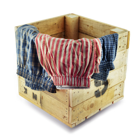 boxer shorts: Boxer shorts (underwear) for men leaning on a wooden box on white background with clipping path.