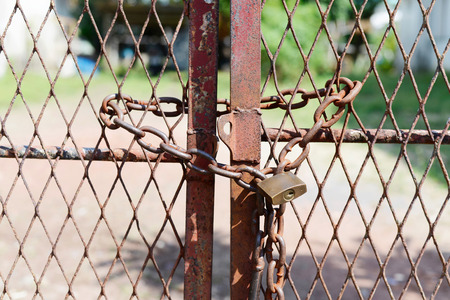 secure brake: Metal door with rusty chain and key locked. Concept security Stock Photo