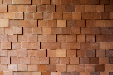 concrete surface finishing: Abstract pattern of decorative stone brick wall surface with cement textured red color background