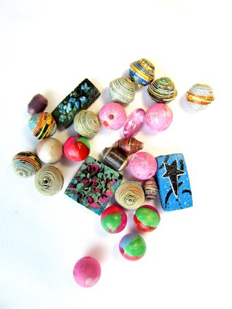 Chaotic heap of various beads, seashells and other accessories items isolated on a white background. Banco de Imagens