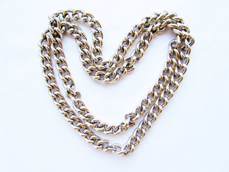 Long chain with large links in the shape of a heart isolated object on a white background.
