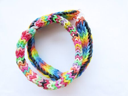 Two children s wicker bracelets from multi-colored little erasers isolated object on a white background. Imagens