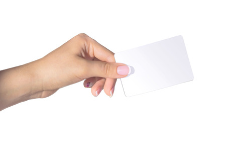 Female hand with french manicure holding card isolated on white background