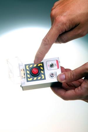 demolishing: Hand-held detonator for bomb