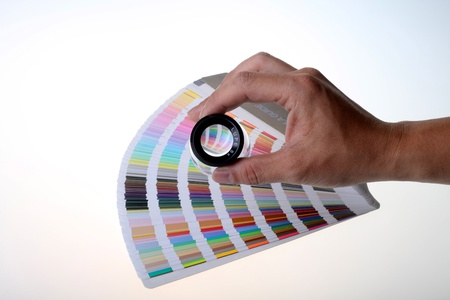 Color chart and magnifying glass photo