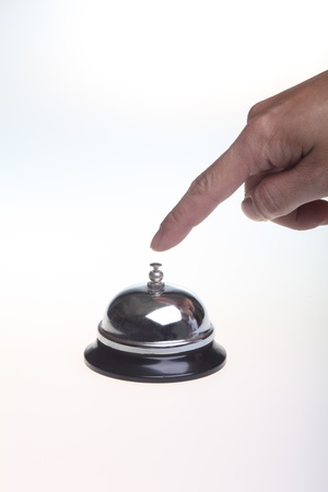 hand bell: Fingered the ring with the call Stock Photo