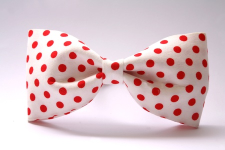 red dot bow tie / red plastic hair accessories Stock Photo - 9826837