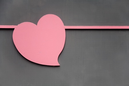 Heart-shaped design with black mesh wall photo