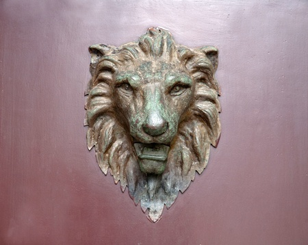 Old lion sculpture on the door
