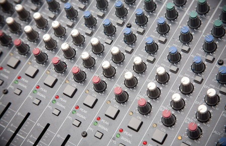 Pro audio mixing board at a concert photo