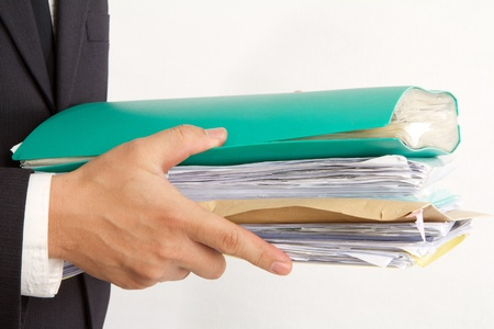 business man with A bunch of folders Stock Photo