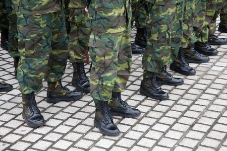 army soldier: Soldiers lined up in camouflage Stock Photo