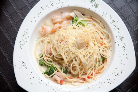 shrimp pasta on white plate photo