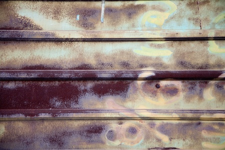 corrugated iron: iron fence Rusty old corrugated iron fence close up. Stock Photo