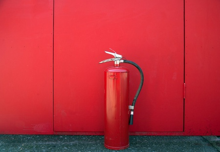 Fire extinguisher located on front of a blue door