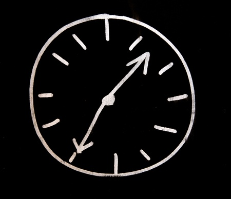 white choc clock on black wall photo