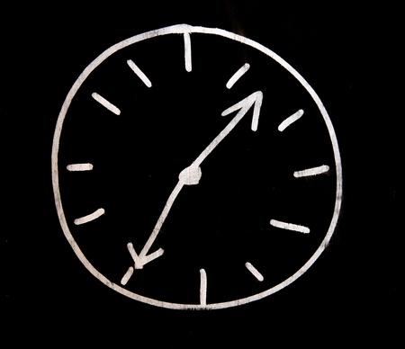 white choc clock on black wall photo