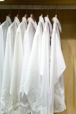 white Shirts hang on Cabinet photo