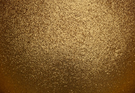 Gold paint background and sequins Stock Photo