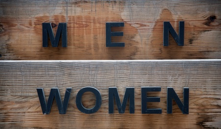 men and  women signs on wood board photo