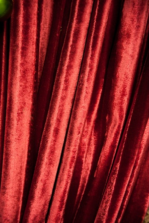 draped: red luxury Curtain on wall Stock Photo