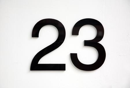23: black number 23 on door