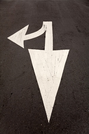 white arrow sign on road photo