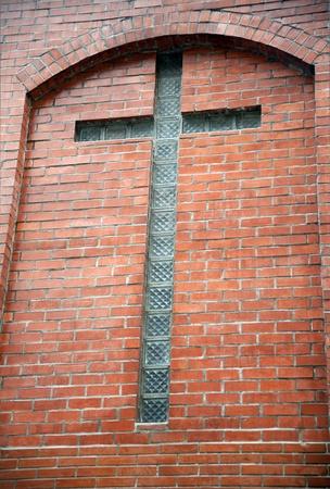 glassmade  cross on brick wall
