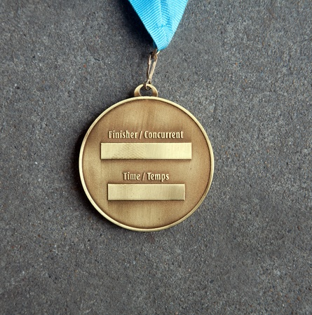 The back of a gold medal at Medals photo